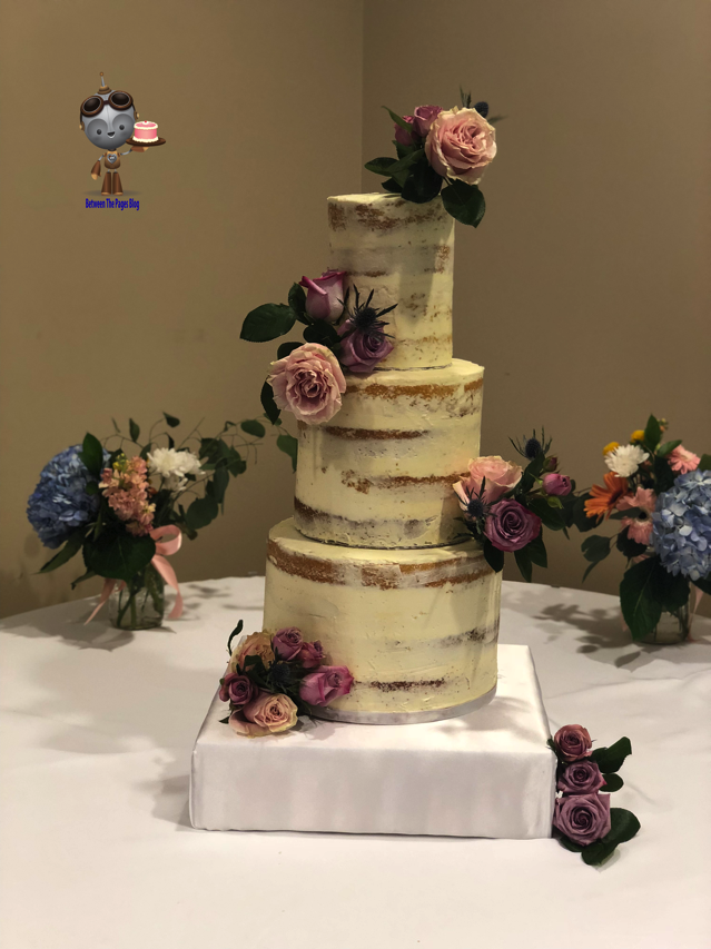 Semi Naked Wedding Cake with flower corsages